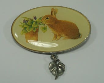 Rabbit Sniffing The Violets Oval Pin / Brooch With A Small Leaf Charm From Marjolein Bastin Hallmark