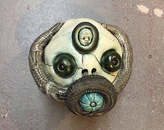 Gasmask, mummy, wall hanging, ceramic head