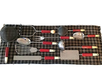 A J stainless utensil 10 piece set - Red and white bakelite handles - Circa 1940s to 1950s