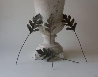 four vintage rusty tin fern leaves