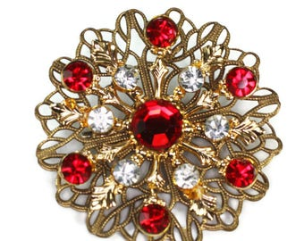 Red and Clear Rhinestone Filigree Brooch Gold Tone Atomic Style Vintage