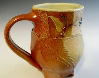 Salt Fired Double Faceted Footed Mug with Flowering Vine