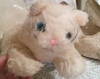 vintage toy cat, white fluffy cat, sad cat toy, original vintage label, blue eyes pink nose, well loved