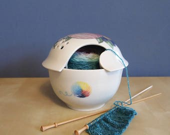 yarn bowl with tattoo flowers and colorful pink yarn