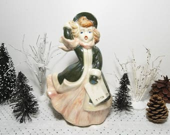 vintage Ceramic Christmas Caroler Statue with Noel Carol Book. Blustery winter day. Iridescent, Pearlescent Finish.
