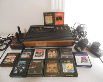 """Vintage Atari CX-2600 """"Light Sixer"""" 6 Switch Woody Console with Cords, Controllers and 12 Games Tested and Works"""