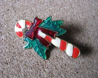 Sweet little vintage metal candy cane pin brooch with green bow
