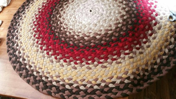 Braided rug brown, red and cream 54""