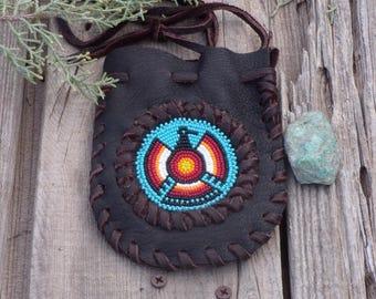 Leather medicine pouch , beaded Thunderbird neck bag