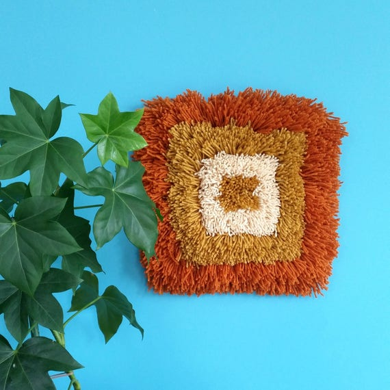 Shaggy latch hook wall hanging. Mustard and orange yarn art. Modern geometric textile art. 70s shag pile.  Retro interior decor.