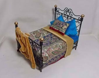 Dolls House Black and Gold double Bed dressed with Exotic Blues & Golds silks and velvet.