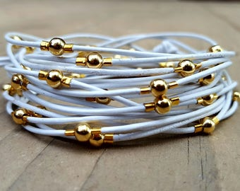 Multi Strand White Leather and Gold Bead Bracelet