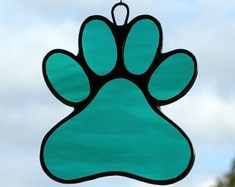 Stained Glass Window Ornament (Paw Print) in Teal Green rippling waterglass