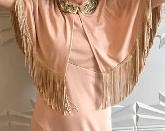 1970's one shoulder maxi dress w/ fringed cape in blush pink.