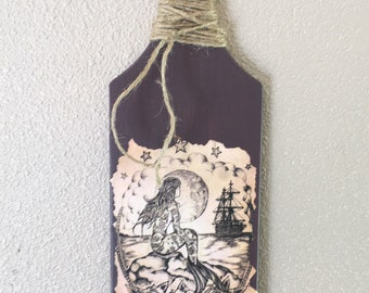 Wood paddle with mermaid image