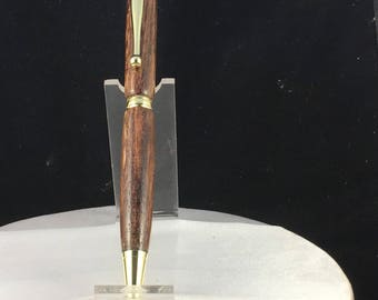 Handcrafted wooden twist type pen.  Hawaiian Macadamia Nut (Gold)