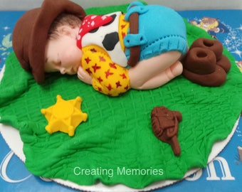 BABY SHOWER Edible Cake topper Woody Inspired topper made of Fondant ready for your cake Baby Boots laying on a green blanket