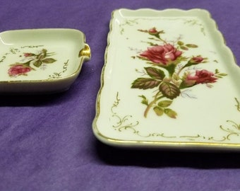 Two of Three pieces to a Mid century porcelain smoking set.  One cigarette tray and one ash tray.  Moss Rose and made by Royal Sealy, Japan.