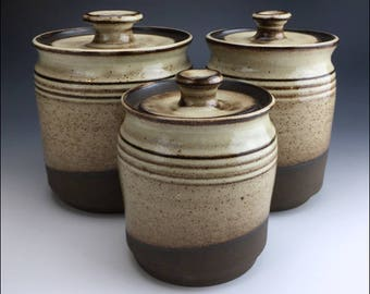heavy ceramic 3-PIECE CANISTER SET | wheel-thrown pottery, ribbed body, shino cream glaze, black clay, lidded, banded, and ready for use
