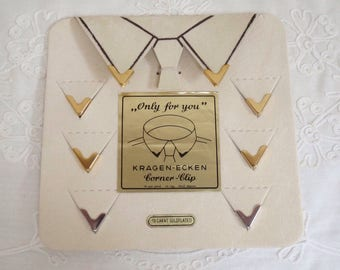 Vintage collar clips on display card