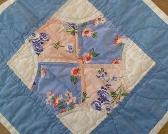 Blue and Pink Floral Quilt