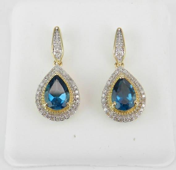 London Blue Topaz and Diamond Halo Drop Earrings Yellow Gold December Gemstone