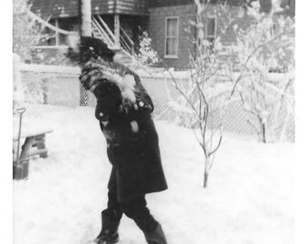 "Vintage Snapshot ""Blizzard Conditions"" Snowstorm Snowball Fight Woman Wearing Black Coat & Hat Found Vernacular Photo"