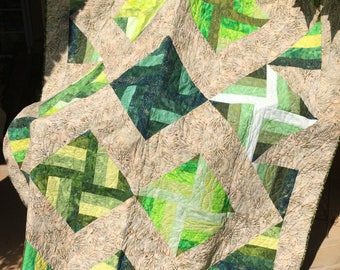 Beautiful bed quilt or large throw , mainly greens