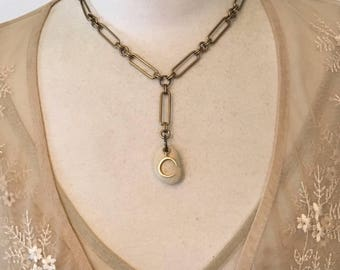 Smooth river pebble on vintage chain with crescent moon