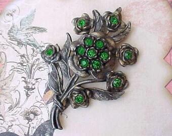 Big Beautiful Art Deco Pot Metal Floral Brooch with Emerald Colored Stones