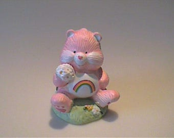 Vintage ceramic pink care bear with daisies