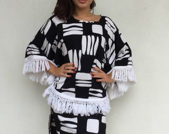 Chic 60s black and white fringed poncho-esque dress