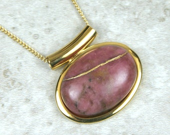 Kintsugi (kintsukuroi) rhodonite stone cabochon with gold repair in a gold plated setting on gold chain - OOAK