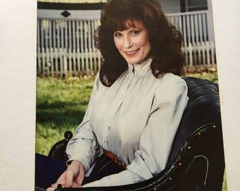 Matted photo of Loretta Lynn.