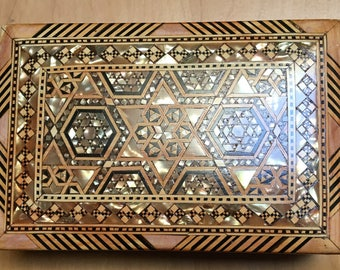 Mother of Pearl inlay wooden box.