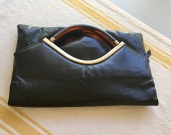 Vintage black fold clutch lucite handles