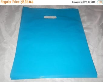 On Sale 50 Glossy Teal Blue Plastic Merchandise Bags size 12x15 Handle Retail Gift Bags wholesale lot