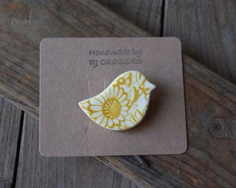 Yellow ceramic bird brooch