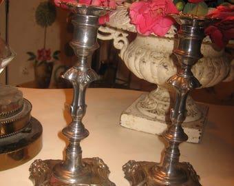 pair of feminine silver candlesticks