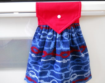 lovely hanging towel with snap over top to conviently hang on an appliance, etc.