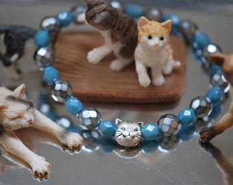 Br-33 Cat-Bracelet stretch bracelet Czech faceted round 6mm opaque powder blue luster and light blue carmen 8mm silverplated cat charm
