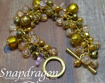 Decadent, fully loaded gold beaded bracelet with toggle clasp