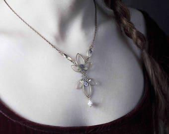FLEUR DE LIS necklace made with old timepieces.
