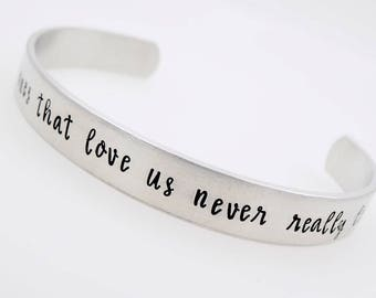 Memorial jewelry,The ones that love us, never really leave us, handstamped adjustable  bracelet grief loss grieving lost loved one death