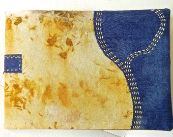 CA 027:un notebook... cotton textiles dyed, embroidered, and sewn