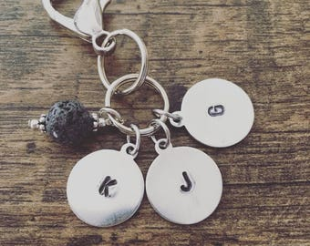Lava Stone Diffuser Keychain with three initial charms