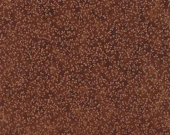 Kaufman brown fabric with mini, white, leaf design.