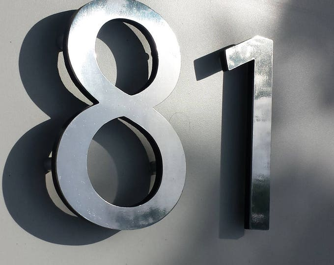 """Polished aluminium modern 3D 6"""" high house sans serif numbers in Myriad Pro, marine lacquered with floating standoff g"""