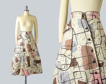 Vintage 1950s Skirt | 50s Atomic Novelty Print Cotton Barkcloth Metallic Starburst Pocket Asymmetrical Button Down Full Skirt (xs)