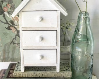 A delightful set of painted white mini drawers